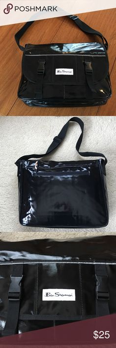 🎉Cyber Monday Sale👏 Ben Sherman 💼‼️ This bag has never been used. It is a shiny black vinyl and has a divided interior with a padded section for a laptop and another area for papers, etc.   It is great condition; has a very faint musty odor because it has been in storage. I am confident this will go away quickly, hopefully before it is shipped to you! Ben Sherman Bags Messenger Bags