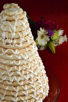 Ring cake or kransekake cake is a traditional Norwegian wedding cake. It is actually an almond based cookie baked into a total of 18 rings of different size and is stacked to form a tower starting from the largest ring to the smallest. The texture is kind of interesting: Crunchy from the outside and chewy from the in