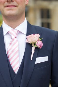 pink and white stripe tie and pink rose boutonniere #navy #pinkhttp://www.weddingchicks.com/2013/12/09/elegant-english-wedding/