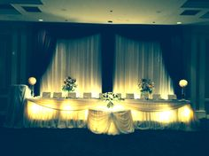 backdrop with crystals & chiffon head table