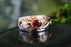 Lovingly handcrafted in 14k white and 18k yellow gold, with red spinel. Designed and created by Melissa Caron at 608 Courtney St, Victoria, BC