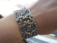 """~This is a stunning, women's silver bracelet~a wide silver engraved cuff bracelet. I am unsure if it is sterling or not but it is a thick, heavy piece of jewelry. Each silver square measures 1"""" in wid"""