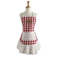 Wrap yourself in this charmingapronto keep holiday party outfits free from stains and splatters.Product: Apron...