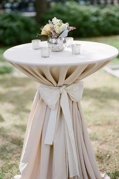 4 standing tables outside on the patio for cocktail hour, Willow green sash to tie ivory tablecloth