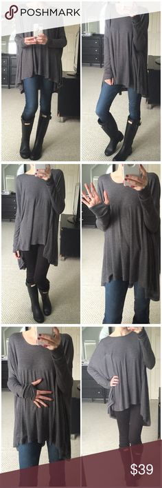 LAST ITEM▫️Soft Grey Long Sleeve with Thumb Holes The softest softest poncho style top with long sleeves and thumb holes! Just obsessed! Very wide dolman sleeve cut! Oversized fit for sure! Looks so cute with leggings! Perfect running errands top! Everyday wear for sure! Modeling S/M. 65% polyester 35% rayon. *Bundle 2+ items for a discount. Tops Tees - Long Sleeve