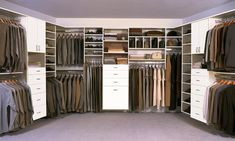 Large White Walk-In Closet by Classy Closets. Utilize your closet space, schedule a free appointment today! http://classyclosets.com/appointment.php #classyclosets #morethanclosets #customclosets