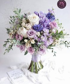 Numerous brides may know the wedding event flower they desire in their own bouquet, but are a little mystified about the remainder of the wedding flowers needed to complete the event and reception. Purple Flower Bouquet, Purple Wedding Bouquets, Prom Flowers, Wedding Flower Arrangements, Bridal Flowers, Flower Bouquet Wedding, Floral Bouquets, Lavender Bouquet, Prom Bouquet