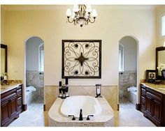 These small arches give a little more privacy than other versions I've seen.  Master bath with walk in shower behind tub area.