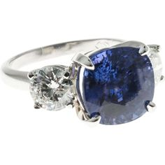 Very rare no heat certified purplish blue cushion Sapphire. Impressive 7.72ct size with a white round brilliant cut diamond on each side. Solid