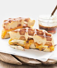 Sandwiches made with waffles yield sweet and savory results. Recipe: Apple-Cheddar Waffle Panini   - CountryLiving.com