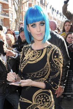 Katy Perry rocks blunt bangs AND a blue 'do. http://on-msn.com/GKJQ2m