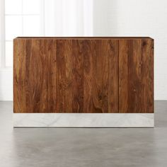 Shop Mateo Marble Credenza. Natural hardwood and Satwariya marble couple handsomely in this substantial furniture piece by Mermelada Estudio.