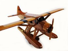One of the most popular general aviation aircraft, this solid mahogany Beaver Airplane is a wonderful scale model replica of the real thing! Wooden Airplane, Airplane Crafts, Wood Plane, Arts And Crafts House, Sand Crafts, Vintage Airplanes, Wooden Animals, Wooden Gifts, Wood Toys