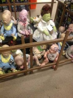 My friend decided to put her baby with all the Zombies at the halloween store.