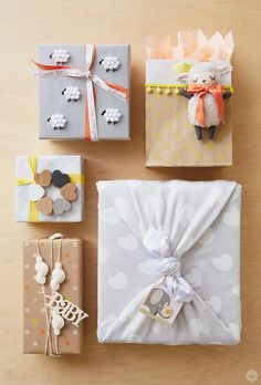 If you're headed to a baby shower, try these gift wrap ideas to really make your gift memorable. With a little DIY magic and a sweet pattern, you can perfectly wrap a baby shower gift! 5 Gift Wrap Ideas: Add a lamb to a bag Tie a heart-covered blanket ar Baby Gift Wrapping, Baby Shower Wrapping, Gift Wraping, Creative Gift Wrapping, Christmas Gift Wrapping, Creative Gifts, Baby Shower Gifts, Birthday Gift Wrapping, Diy Baby Shower Gift Wrap