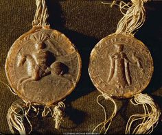 Two wax seals: Ludwig von Ysenburg on horseback (left), his wife Helwig with falcon (right), both from 1274. Castle, Buedingen, Germany
