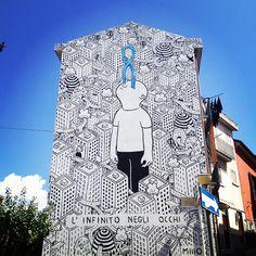 Millo - Street art. La ricerca del rapporto tra l'essere umano e il paesaggio che lo circonda attraverso murales in bianco e nero intervallati da lampi di colore accesi.