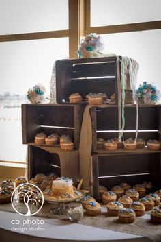 We used cupcakes from Costco. Ground up graham crackers and Nilla wafers sprinkled on top, and wilton candy melts melted into seashell shapes. The display was made from 5 milk crates covered with strips of burlap with our bouquets placed on top after the ceremony.