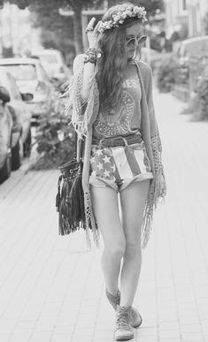Summer music festival outfit: flower crown, Lennon shades, American flag high-waist shorts, fringe, rocker tee.