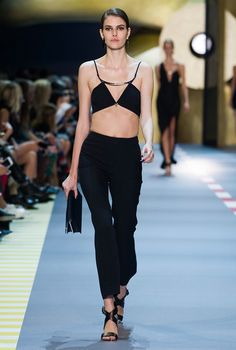 Mugler under David Koma's watch is all about showing skin and bodycon silhouettes. For the brand's spring 2016 show, the designer paired high-waist pants with the bra top for a sexy result.