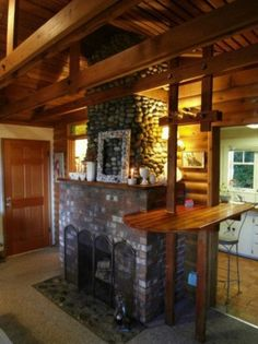 like the fireplace and mantle    seaview-seattle-cottage-009