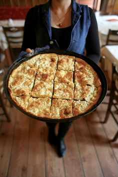"Feta Tart: 6 tbsp. extra-virgin olive oil  2 tsp. vodka  1 egg  1 1⁄4 cups flour, sifted  1⁄4 tsp. kosher salt  1⁄8 tsp. baking powder  10 oz. feta, crumbled   2 tbsp. unsalted butter, softened    1. Heat oven to 500°. Put an 18"" x 13"" x 1"" rimmed baking sheet into oven for 10 minutes [Cont. below]"