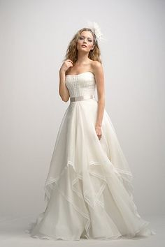 Ivory strapless washed silk organza ball gown with delicate beaded lace strips on bodice, natural waist with vanilla bean double faced satin ribbon, a-line skirt with washed silk organza overlay and a sweep train