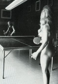 """Henry Miller playing Ping-Pong with a naked Lady  """"I keep the Ping-Pong table handy for people I don't want to talk to. You know, it's simple. I just play Ping-Pong with them.""""  """"I started at the age of 10 on the dining room table. I take on players from all over the world. I play a steady, defensive Zen-like game. The importance of my recreation lies in preventing intellectual discussions. No matter how important or glamorous an opponent may be, I never let him or her distract me.""""  HM,1971"""