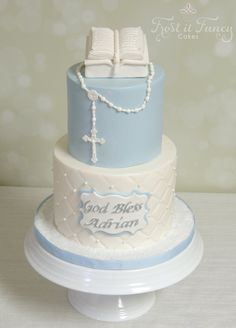 "https://flic.kr/p/DcSzi7 | Adrian | Little Adrian Baptismal Cake  5"" and 7"" Top Tier: Chocolate chip with cookie dough filling and iced with vanilla buttercream. Botton Tier: Marble cake with vanilla buttercream.  Topped with our scratch made MMF. Little bible is all edible, made out of rice crispy and covered with fondant."