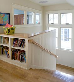 Shelves along the top of a landing are perfect for storing books. If you don't have a linen closet, deep shelves like these are perfect for storing extra towels and sheets. Outfit the shelves with pretty baskets and tuck the linens inside.