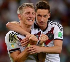 Bastian Schweinsteiger and Julian Draxler celebrate
