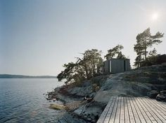 In a summer retreat designed for a young family, Stockholm-based architects from Claesson Koivisto Rune combined natural materials with modern, minimalist look to gently fit the structure into stunning landscape of Kråkmora Holmar island. Stockholm Archipelago, Swedish Cottage, Scandinavian Style Home, Scandi Style, House By The Sea, Cool Landscapes, Runes, Architecture Design, Images