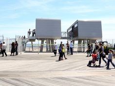 Sustainable modular buildings open along New York's beaches as part of the disaster recovery effort after Hurricane Sandy. The designer created a very unique look and a very green specification for these prefab modular buildings.