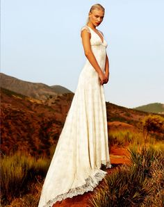 Beaded lace wedding dress with cap sleeves and full train by Amanda Wakeley