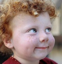 Perfect freckles, blue eyes, dimples, and red curls.and mischief written all over this little face!