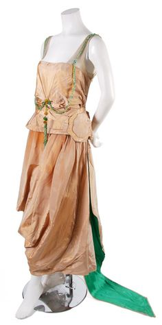 French Couture Silk Taffeta Evening Dress, 1919, with a beaded trim at neckline, skirted waist with a floral applique. Property from the Collection of Katharine (McLane) Tiffany Abbott, the granddaughter of the founder of Tiffany.