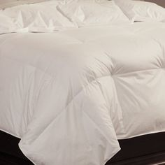 """Pacific Coast Feather Grandia Winter Warm Weight Oversized Queen Down Comforter - White by Pacific Coast. $189.95. Up to 20 percent larger than most comforters (90"""" x 98""""). 550 fill power 38 ounces fill weight Allergy-FreeTM, Pacific Coast® down. Breathable insulation for comfortable body temperature. 370 thread count; 100 percent cotton cover. ComfortLock® 15-inch box design ensures fluffiness. Pacific Coast ® Grandia Down Comforters - Featured in the Finest Ritz-Carlton ®..."""