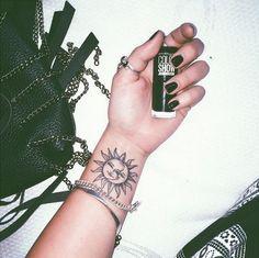 Sun/ Moon tattoo on wrist