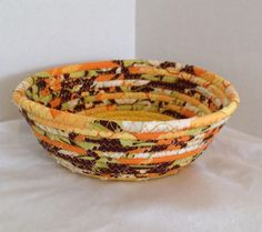 A personal favorite from my Etsy shop https://www.etsy.com/listing/548060874/fabric-pottery-coiled-fabric-bowl-basket