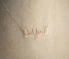 get wire and shape it into any quote or shape then attach it to a chain.