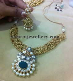 Jewellery Designs: Gold Swirls Necklace with Jhumkas