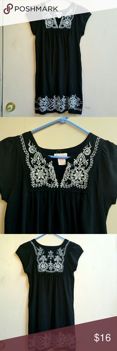 """Gorgeous Embroidered Dress Love, love, love! this black dress of 100% rayon.  It has extensive white embroidery on the yoke & hem!  Worn only a couple times (it was too small for me so I got a bigger size.) Comfy shift to wear anywhere!  Size small, (juniors) 17"""" underarm to underarm + a bit more in the gathers, 24"""" width across hem, 31.5"""" length from shoulder. One Clothing Dresses Mini"""