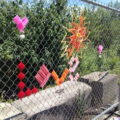 Yarn art on a chain link fence. Found in #pdx