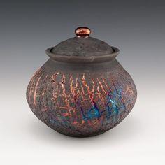 @d_earl  Read the original post below. ・・・ Raku and sodium silicate jar from last year. #raku #sodiumsilicate #pottery #wheelthrown #wheelthrownpottery