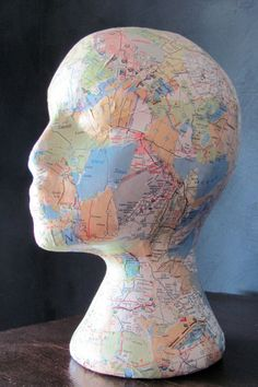 Decorative Map foam head (map decoupage). $50.00, via Etsy.