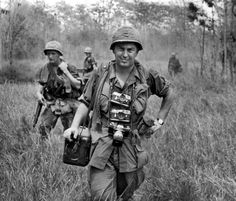 Vietnam 1967 -- AP photographer Horst Faas, with his Leica cameras around his neck, accompanies U.S. troops in War Zone C. (AP Photo/Horst Faas collection)