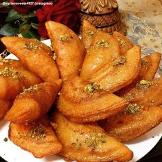 Qatayef: Middle-Eastern Dessert for Epiphany. Qatayef is a middle-eastern filled pancakes that Christians eat on Epiphany day and Muslims during Ramadan. The filling can be either walnuts or cheese. Extremely tasty and definitely leaves a great impression!  print recipe and video