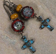 Little Southwestern Crosses, There's just a little bit of the Southwest in these boho earrings. Little Southwestern crosses with a verdigris patina, deep red Czech flowers and mustard yellow handmade Lampwork beads, hypoallergenic niobium earwires.