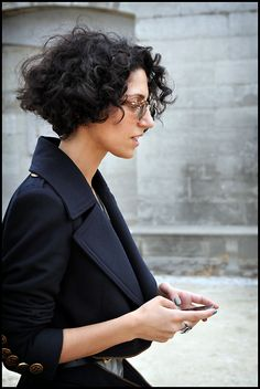 Yasmine Sewell - sculpted coat and hairdo - tres chic