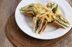 Semar Club Sandwich  Layered Sandwich with crispy chicken, cheese, tomato, cucumber, egg, and lettuce comes with fries.